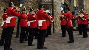 Members of the 1st Battalion Welsh Guards band playing outside Cardiff Castle