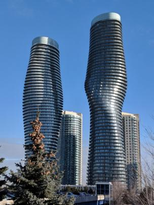 Two tall silver skyscrapers