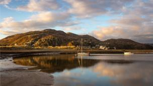 Boats lay still at sundown on the magnificent Mawddach Estuary, a serene scene captured by Barbara Fuller