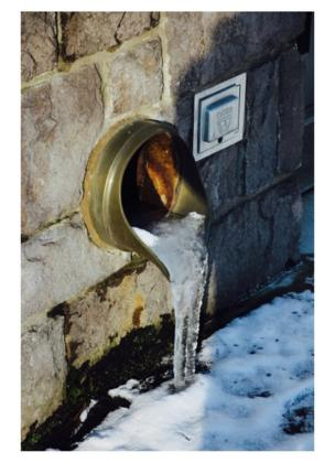 Frozen water coming out of a pipe