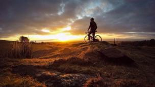 Cyclist with sunset