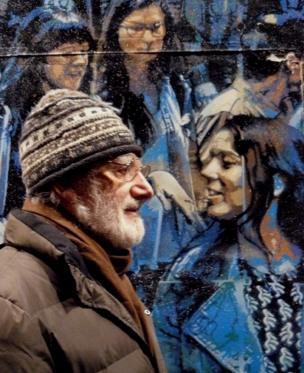 Man passing a mural