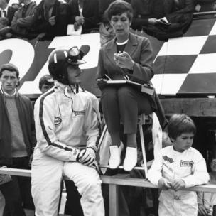 July 1967: British racing driver Graham Hill with his wife and his six-year-old son Damon, who went on to become a world champion driver himself, at Silverstone.