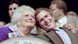 The Bush family, (L-R) Texas Governor and presidential candidate George W., Florida Governor Jeb, former US president George and his wife Barbara watch play during the Foursomes matches 25 September 1999