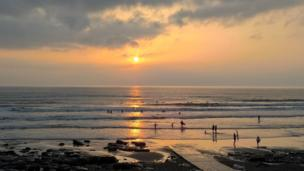Sunset and surfers at Rest Bay in Porthcawl were captured on camera by Susan Reynolds