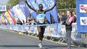 Berard Rotich crosses the finish line of the Belfast City Marathon, 1st May 2017