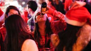 Revellers take part in SantaCon on December 10 2016 in New York