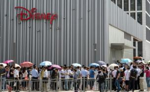 Long queue outside China's first official Disney store, in Shanghai, on 20 May 2015.
