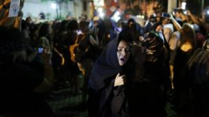 Women protest against gender violence in Asuncion, Paraguay, Wednesday, Oct. 19, 2016