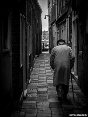 Man walking a street in Venice