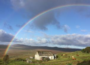 Rainbow over cottage