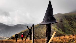 A witches hat on a fence post in Snowdonia