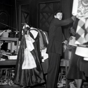French aristocrat and fashion designer Hubert de Givenchy backstage at 1952 fashion show, in black and white image