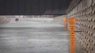 A gauge shows the depth of water in an underpass on Interstate 10 which has been inundated with flooding from Hurricane Harvey (27 August 2017)
