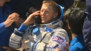 Tim Peake on the phone after landing