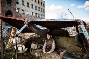 A girl sits in a car