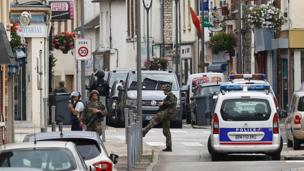Police and soldiers cordon off streets