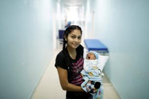 Jasmilfer, 23, a Venezuelan from Monagas state, holds her five-day-old baby Arjunea at a maternity hospital in Boa Vista, Roraima state, Brazil, 21 August 2018
