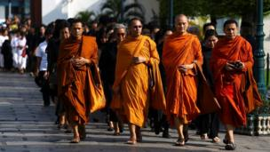 Buddhist monks offer condolences for the Thai king