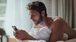 Man textin on a phone