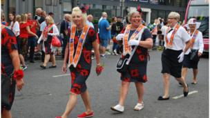 Women from the Orange Order take part in the parade in Belfast