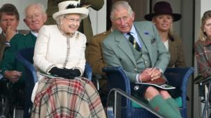 Queen Elizabeth II and Prince Charles, Prince of Wales watch the action during the Braemar Highland Games on September 6, 2014 in Braemar, Scotland. The Braemar Gathering is the most famous of the Highland Games and is known worldwide