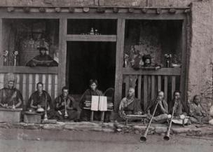 A row of buddhist Musicians, Darjeeling