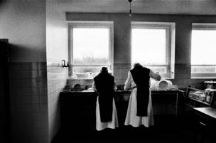 Monks working in the kitchen at Sancta Maria Abbey at Nunraw, East Lothian