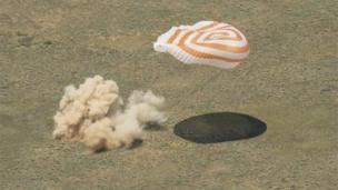 The Soyuz capsule as it hits the ground in Kazakhstan