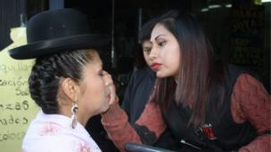 A woman applies make-up to one of the participants in the 2018 event