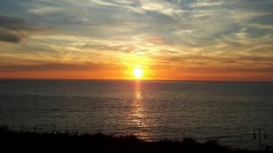 Mair Jones captured the sun dipping beneath the Cardigan Bay horizon