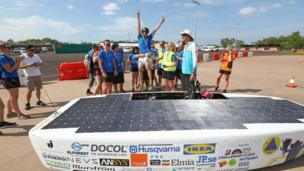 Team members congratulate the driver after Solveig, the car from Sweden's JUsolarteam team, passes testing in Darwin. Photo: 6 October 2017