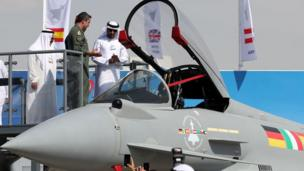 Crown Prince of Dubai, Sheikh Hamdan bin Mohammed bin Rashid al-Maktoum (R), looks at an Eurofighter Typhoon fighter jet during the Dubai Airshow on November 14, 2017, in the United Arab Emirates.