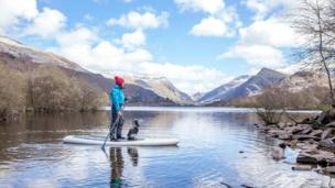 Sian Sykes and Ruby enjoy a moment of pre-Christmas peace and solitude paddle boarding in Llanberis. Would you like to see your picture featured? Send it to newsonlinepictures@bbc.co.uk with your details and information about how you came to take the photograph.