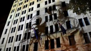 World War I images are projected on a building at the Cenotaph during the Anzac Day dawn service in Sydney (25 April 2018)
