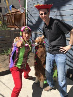 Befuddled SXSW participant Anthony Zurcher poses with a Peruvian and his stuffed llama.