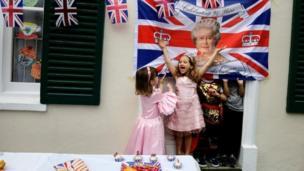 Children at L'Ecole des Petits in London bilingual primary school celebrate Queen Elizabeth's 90th birthday in London, Britain June 10, 2016