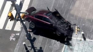 An aerial shot of a badly damaged car that drove into pedestrians in New York