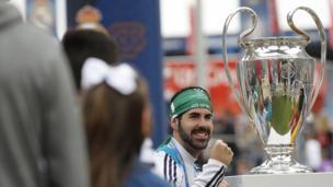 Fan with replica trophy