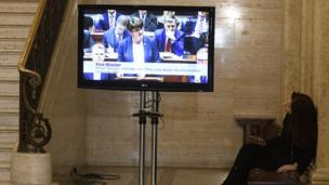 Arlene Foster on screen at Stormont