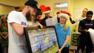 """Midfielder Aron Gunnarsson said: It's a yearly event for us. The lads come here and try to put a smile on the kid's faces. We bring some gifts and spend some time chatting with them and their families during what are obviously difficult times. It's a nice day."""""""