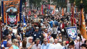 Orange Order members and bands parading along Royal Avenue in Belfast, 12 July 2017