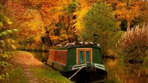 Autumnal trees and a canal boat in Llangollen