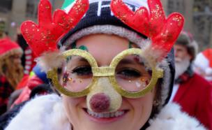 A reveller sports seasonal decorations in the annual SantaCon event in Manhattan, New York, December 10, 2016