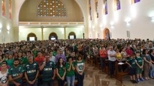 Fans at a church service in Chapeco