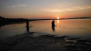 Traditional lave net fishermen at sunrise at Black Rock, Portskewett, Monmouthshire, courtesy of Martin Morgan.