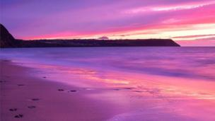 A colourful sunset at Penbryn beach in Ceredigion