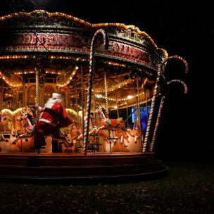 in_pictures Father Christmas on a merry-go-round