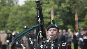 A piper marks the commemorations in Cardiff