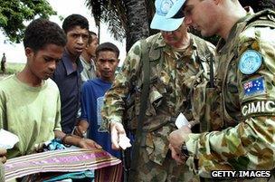 Australian troops buy souvenirs before leaving East Timor, 2005